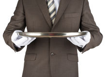 Male waiter holding tray Stock Photo