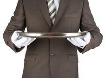 Male waiter holding tray. Isolated on white background Stock Photo