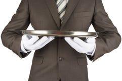 Male waiter holding tray. Isolated on white background Stock Image