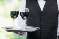 Male waiter holding tray with wine glasses Royalty Free Stock Photography