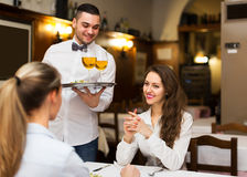 Male waiter serving guests table Royalty Free Stock Photo