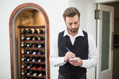 Male waiter taking down order Royalty Free Stock Images