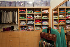 Male walk in wardrobe. With shirts, pants, belts and drawers Royalty Free Stock Photography