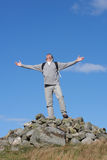 Male Walker Standing On Pile Of Rocks Stock Photography