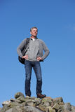 Male Walker Standing On Pile Of Rocks. Smiling Male Walker Standing On Pile Of Rocks Stock Photos