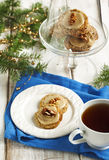 Male walnut cookies. And cu of tea Royalty Free Stock Image