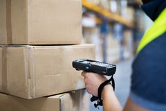 Male warehouse worker with barcode scanner. Unrecognizable male warehouse worker with barcode scanner Royalty Free Stock Images