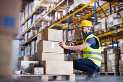Male warehouse worker with barcode scanner. Young male warehouse worker with barcode scanner Stock Photos