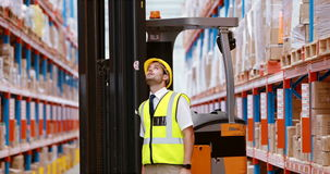 Male warehouse worker checking stock for shipping stock video footage