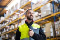 Male warehouse worker with clipboard. Portrait of a young male warehouse worker with clipboard Stock Photos