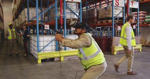 Male warehouse worker using VR headset and controller in loading bay 4k stock footage