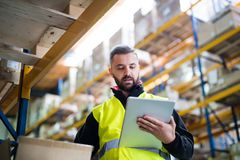 Free Male Warehouse Worker With Tablet. Royalty Free Stock Photos - 108248388