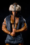 Male warrior with sword raised. The image of the barbarian Royalty Free Stock Photo