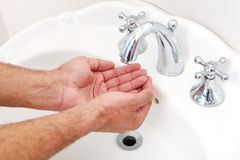 Male washing her hands in bathroom Royalty Free Stock Photography