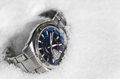 The Male watch on snow. Stock Photos