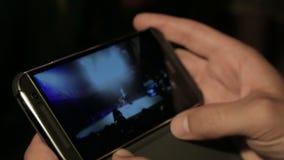 Male watching break-dance battle video on mobile phone, modern technologies. Stock footage stock video footage