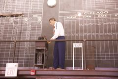 A male wax figure updates cotton prices in the Memphis Cotton Museum. A wax figure of a man updating cottons prices on display inside the Memphis Cotton Exchange Royalty Free Stock Photos