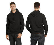 Male wearing blank black hoodie. Young male with blank black hoodie, front and back. Ready for your design or artwork Stock Photo