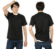Male wearing blank black shirt. Young male with blank black t-shirt, front and back. Ready for your design or logo Royalty Free Stock Image