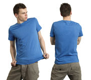 Male wearing blank blue shirt. Young male with blank blue t-shirt, front and back. Ready for your design or logo stock images