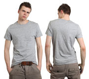 Male wearing blank gray shirt. Young male with blank gray t-shirt, front and back. Ready for your design or logo Royalty Free Stock Photos