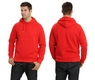 Male wearing blank red hoodie. Young male with blank red hoodie, front and back. Ready for your design or logo Royalty Free Stock Photo