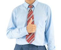 Male wearing blue shirt reaching hand out thumbs up with clipping path. Close up, Male wearing blue shirt and red tie reaching hand out thumbs up with clipping royalty free stock photos