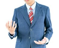 Male wearing blue in suit reaching hand out with clipping path. Close up, Male wearing blue in suit and red tie reaching hand out isolated with clipping path royalty free stock photos