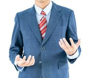 Male wearing blue in suit reaching hand out with clipping path. Close up, Male wearing blue in suit and red tie reaching hand out isolated with clipping path stock photos