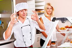Male wearing chef uniform. Male chef wearing uniform at cafeteria Stock Image