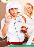 Male wearing chef uniform. Male chef wearing uniform at cafeteria Royalty Free Stock Images