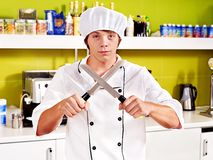 Male wearing chef uniform. Male chef wearing uniform at cafeteria Royalty Free Stock Photos