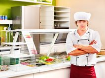 Male wearing chef uniform. Male chef wearing uniform at cafeteria Stock Photos