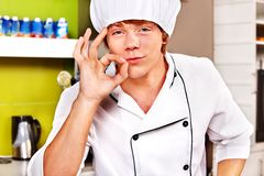 Male wearing chef uniform. Male chef wearing uniform at cafeteria Stock Photography
