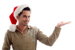 Male wearing christmas hat and holding something Royalty Free Stock Photos