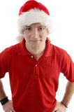 Male wearing christmas hat looking at camera. Against white background Stock Photography