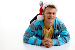 Male wearing christmas hat and looking at camera. On an isolated background Stock Photos