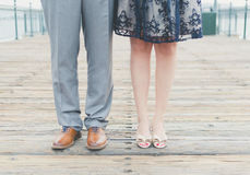 Male Wearing Gray Pants and Brown Leather Shoes and Female Wearing Beige Sandals Royalty Free Stock Image