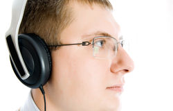 Male wearing head phones Royalty Free Stock Images