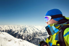 Male wearing ski equipment with copy space. Male wearing ski equipment stands on top of high European Alps, ready for the winter season Royalty Free Stock Photography
