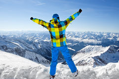 Male wearing ski equipment on top of world. Male wearing ski equipment being excited about climbing on top of European Alps on a sunny winter day Royalty Free Stock Photography