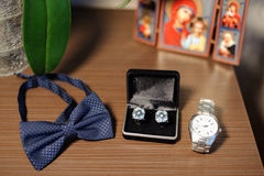 Male Wedding Accessories. On table with icon Royalty Free Stock Photo