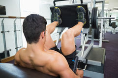 Male weightlifter doing leg presses in gym Royalty Free Stock Photography