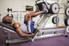 Male weightlifter doing leg presses in gym Royalty Free Stock Photo
