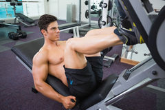 Male weightlifter doing leg presses in gym Royalty Free Stock Photos