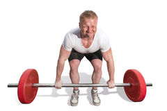 Male weightlifter sat down and raises the bar. On isolated background Royalty Free Stock Photography