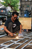 Male welder/fabricator welding metalwork in workshop. Kuta/Bali - September 13, 2016: Male welder/fabricator welding metalwork in workshop Stock Photo