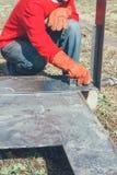 Welder makes measurements of metal parts steel ruler angle bracket Royalty Free Stock Image