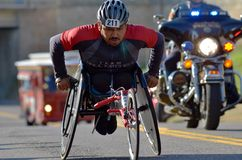 Male Wheelchair Marathoner. Minneapolis - October 2, 2011 - Unidentified male wheelchair competitor climbing a hill in the 2011 Medtronic Twin Cities Marathon Stock Photos