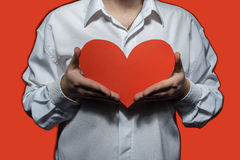Male white shirt that holding a big red heart. Valentine`s Day Royalty Free Stock Images